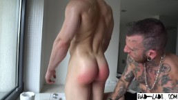 Muscle twink's wet bubble bum spanked hard in the shower